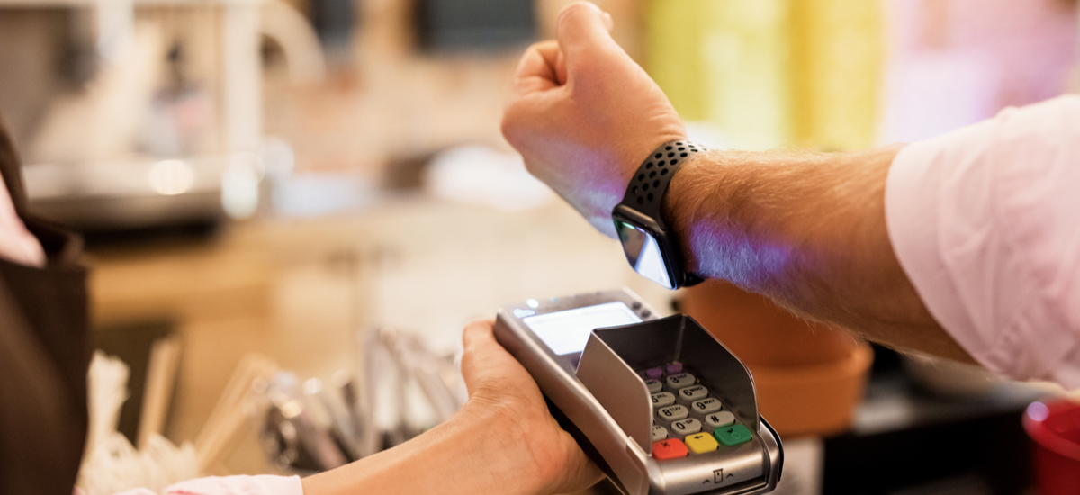 Man paying with Apple Watch